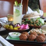 A Tabule Plate - Freshly squeezed mint limeade, mezze- fried eggplant, falafel, cauliflower, tabule, pickles and pita.